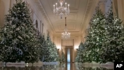 "The Cross Hall are decorated with ""The Nutcracker Suite"" theme is seen during a media preview of the 2017 holiday decorations at the White House in Washington, Monday, Nov. 27, 2017. (AP Photo/Carolyn Kaster)"