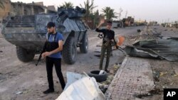Iraqi security forces and tribal fighters regain control of northern neighborhoods after overnight heavy clashes with Islamic State militants in Ramadi, April 23, 2015.
