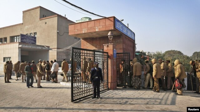 Policemen report for duty at a district court, where the accused in a gang rape are to be produced for trial, in New Delhi, India, January 10, 2013.