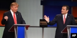 FILE - Republican presidential candidate businessman Donald Trump, left, and rival Sen. Ted Cruz, R-Texas, both speak during the Republican presidential debate in North Charleston, S.C, Jan. 14, 2016.