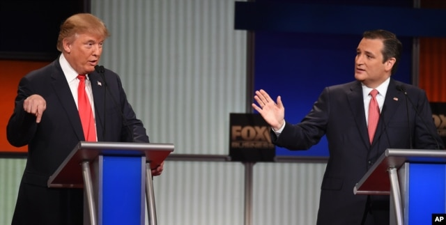 Republican presidential candidate businessman Donald Trump, left, and rival Sen. Ted Cruz, R-Texas, both speak during the Fox Business Network Republican presidential debate at the North Charleston Coliseum, Jan. 14, 2016, in North Charleston, S.C.