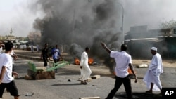 Protesters burn tires amid a wave of unrest over the lifting of fuel subsidies by the Sudanese government, Sept. 25, 2013.