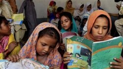 Pakistani girls in Peshawar last year. Their classes were held privately after Islamic militants reportedly blew up their school in an effort to prevent girls from getting an education.