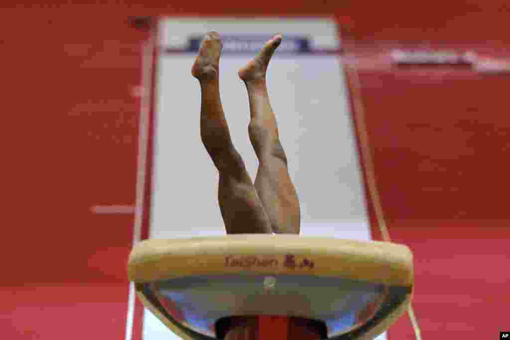 Gold medalist Simone Biles of the United States performs in the women's vault final on the first day of the individual event finals of the of the Gymnastics World Championships at the Aspire Dome in Doha, Qatar.