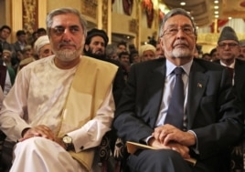 Afghan presidential candidates Abdullah Abdullah, left, and Zalmai Rassoul, right, listen during a news conference in Kabul, May 11, 2014.