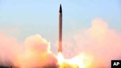 This file picture released by the official website of the Iranian Defense Ministry on Sunday, Oct. 11, 2015, claims to show the launching of an Emad long-range ballistic surface-to-surface missile in an undisclosed location.