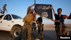 Dakarun Iraki rike da tutar 'yan kungiyar Islama.