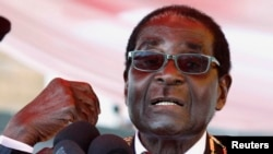 Zimbabwe's President Robert Mugabe addresses the crowd gathered to commemorate Heroes Day in Harare, Aug. 12, 2013.