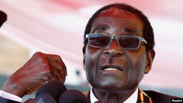 Zimbabwe's President Robert Mugabe is seen addressing a crowd in Harare in this August 12, 2013, file photo.