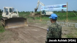 U.N. peacekeepers from South Korea break ground in 2014 in South Sudan's Jonglei state. Bor, the capital, has not suffered seasonal flooding since the 17-kilometer dike was built.