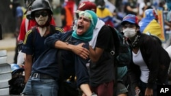 An anti-government protester screams at security forces blocking a march to the Supreme Court to oppose President Nicolas Maduro's plan to rewrite the constitution, in Caracas, Venezuela, July 22, 2017.