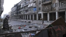 Mannequins are set up to confuse snipers loyal to Syria's President Bashar al-Assad in the old city of Aleppo, December 23, 2012.