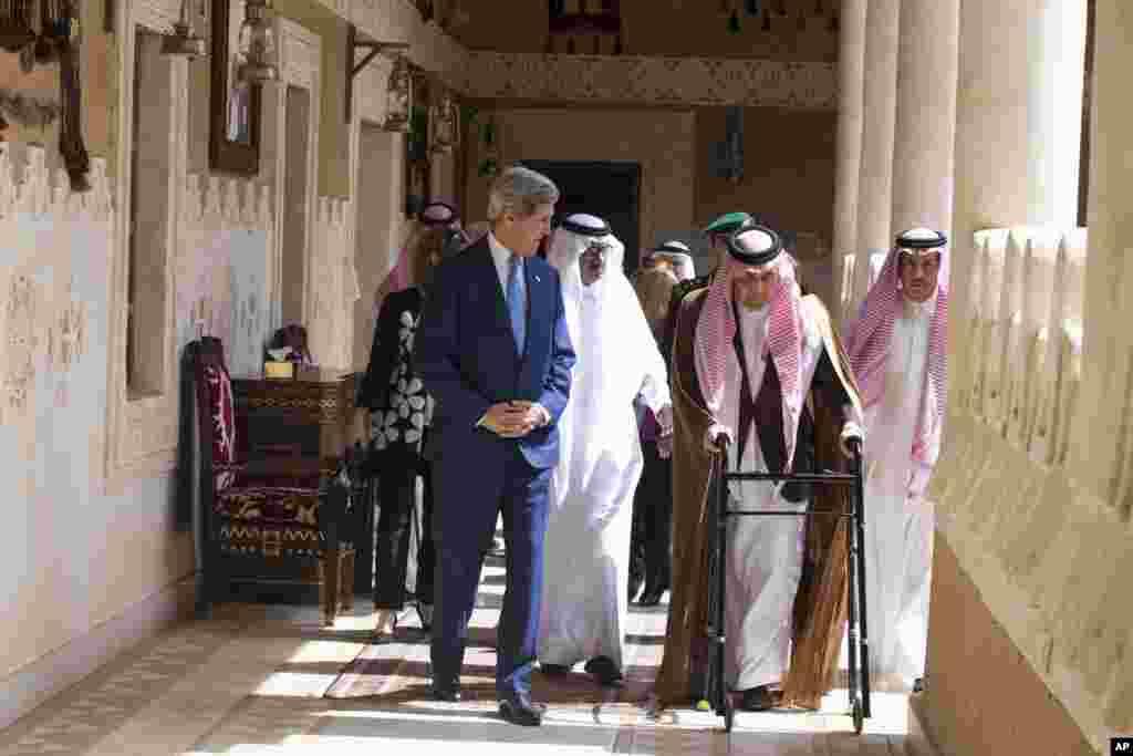U.S. Secretary of State John Kerry walks with Saud bin Faisal bin Abdulaziz al-Saud, Foreign Minister of Saudi Arabia in Diriya, Saudi Arabia, March 5, 2015.