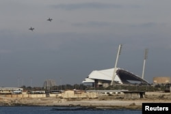 FILE - Russian warplanes fly over the Mediterranean coastal city of Latakia, Syria.