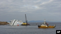An oil recovery sea platform is seen next to the Costa Concordia cruise ship off the west coast of Italy, at Giglio island, January 26, 2012.