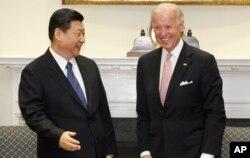 Biden ve Xi, 14 Şubat 2012 tarihine ait bu fotoğrafta Beyaz Saray'ın Roosevelt Salonu'nda görüntülenmiş.