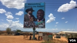 A billboard in South Sudan's capital Juba on April 15, 2016, shows South Sudan's President Salva Kiir (L) and rebel leader Riek Machar (R), who is due to return to the city and assume the vice presidency. (J. Patinkin/VOA)