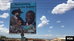 FILE - A billboard in Juba shows South Sudan's President Salva Kiir (L), and rebel leader Riek Machar, April 15, 2016. (J. Patinkin/VOA)