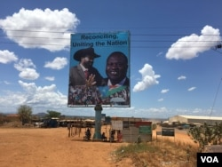 FILE - A billboard in South Sudan's capital, Juba, on April 15, 2016 shows South Sudan's President Salva Kiir (L), and rebel leader Riek Machar (R). (VOA/J. Patinkin)