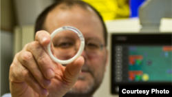 Caption: Northwestern University biomedical engineer Patrick Kiser holds an intravaginal ring - the first of its kind - that reliably delivers an antiretroviral drug and a contraceptive for months. (Northwestern University)