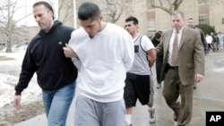 FILE - Suspected members of the MS-13 gang are escorted to their arraignment in Mineola, New York, Jan. 11, 2018.