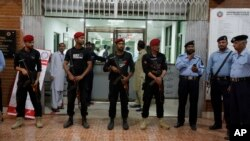 Pakistani police commandos stand guard outside the cardiac ward, where jailed former prime minister Nawaz Sharif was moved, in Islamabad, Pakistan, July 29, 2018.