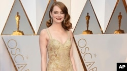 Emma Stone arrives at the Oscars on Sunday, Feb. 26, 2017, at the Dolby Theatre in Los Angeles.