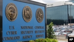 FILE - The National Security Agency in Fort Meade, Maryland, says it will no longer collect Americans' emails and text messages that mention a foreign national targeted for surveillance.