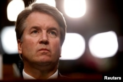 FILE - U.S. Supreme Court nominee Brett Kavanaugh listens during his Senate Judiciary Committee confirmation hearing on Capitol Hill in Washington, September 4, 2018.