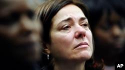 Francine Wheeler, mother of Sandy Hook Elementary School shooting victim Benjamin Wheeler, cries as she listens to Vice President Joe Biden speak during a gun violence conference in Danbury, Conn., Feb. 21, 2013.