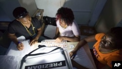 Electoral workers count ballots during their country's general elections, in Port-au-Prince, Haiti, Oct. 25, 2015.