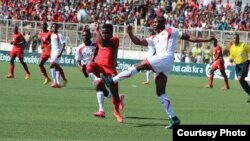 FILE - Malawi, in red, plays against Guinea during the Africa Cup of Nations qualifiers at Kamuzu Stadium in Blantyre in 2016. (Photo courtesy of Patrick Lunda)