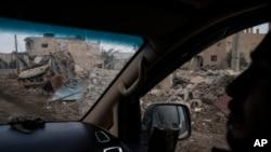 ABŞ-ın dəstəklədiyi Suriya Demokratik Qüvvələrinin döyüşçüləri Suriyada İŞİD militantlarından geri alınana Susah kəndində, 16 fevral, 2019.