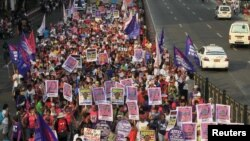 The raid in which Zulkifli bin Hir was killed also left 44 police commandos dead, and a Philippine senate panel held President Benigno Aquino responsible for the bungled operation. Above, protesters march toward the presidential palace in Manila, March 20, 2015.