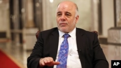FILE - Iraqi Prime Minister Haider al-Abadi is seen speaking to the media.