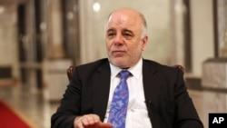 """Thủ tướng Iraq Haider al-Abadi gọi năm 2014 là năm """"khó khăn và đau đớn nhất trong những năm qua"""" đối với người dân Iraq vì các cuộc tấn công của Nhà nước Hồi giáo"""
