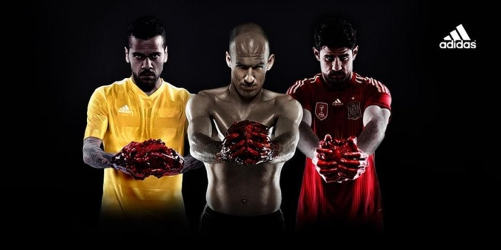 Adidas ad featuring football players holding cow hearts.