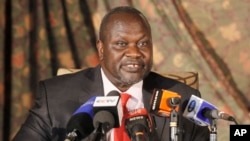FILE - South Sudan rebel leader Riek Machar addresses journalists during a news conference in Nairobi, Kenya, July 8, 2015.