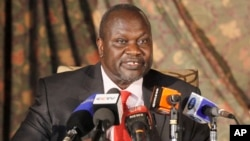 FILE - South Sudan rebel leader Riek Machar addresses journalists during a news conference in Nairobi, Kenya.