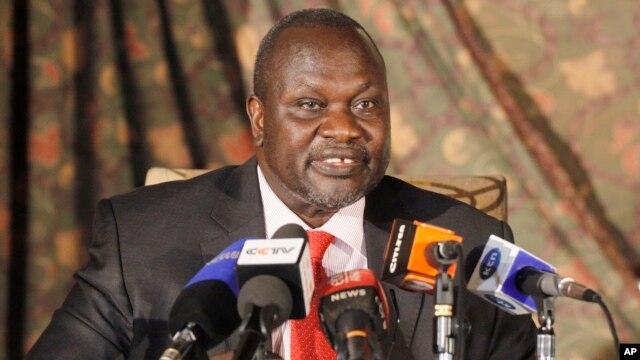 FILE - South Sudan rebel leader Riek Machar addresses journalists during a news conference in Nairobi, Kenya.