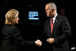 Sen. Kay Hagan, D-N.C., left, and North Carolina Republican Senate candidate Thom Tillis shake hands prior to an Oct. 7 debate.