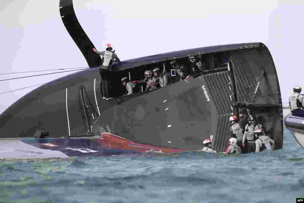 New York Yacht Club American Magic is capsized during Round Robin two, Race three against Luna Rossa Prada Pirelli of the Prada Cup 2021, the challengers series of the 36th America's Cup in Auckland, New Zealand.