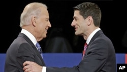 Vice President Joe Biden (l) and Republican vice presidential nominee Rep. Paul Ryan of Wisconsin shake hands before the vice presidential debate at Centre College, in Danville, Kentucky, Oct. 11, 2012.