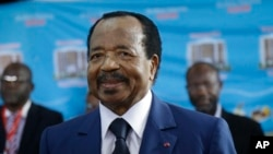 FILE - Paul Biya, of the Cameroon People's Democratic Movement party, waits to cast his vote during the presidential elections in Yaounde, Oct. 7, 2018.
