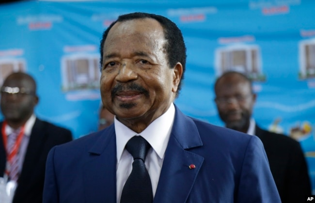 Cameroon's President Paul Biya, of the Cameroon People's Democratic Movement party, waits to cast his vote during the Presidential elections in Yaounde, Oct. 7, 2018.