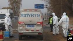 Workers disinfect passing vehicles in an area after the latest incident of African swine flu outbreak on the outskirts of Beijing, China, last November. A recent incident has Taiwan concerned about its spread.