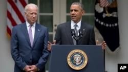 Presiden AS Barack Obama dan Wapres Joe Biden berbicara di Gedung Putih usai keputusan Mahkamah Agung menolak gugatan terhadap 'Obamacare', Kamis (25/6).
