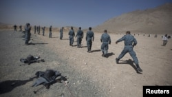 Afghan police recruits train in Kabul.
