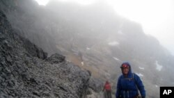 Alan Arnette, here near the summit of Carstensz Pyramid in Indonesia, is climbing the world's tallest peaks to raise Alzheimer's awareness.
