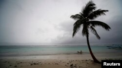 FILE - The beach front of Mahahual is seen as a hurricane approaches the southern part of the Yucatan peninsula, Aug. 7, 2012.